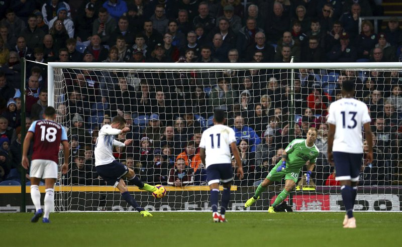 Everton's Gylfi Sigurdsson scores his side's third goal of the game from the penalty spot, during the English Premier League soccer match between Burnley and Everton at Turf Moor, in Burnley, England, Wednesday, Dec. (Dave Thompson/ PA via AP)