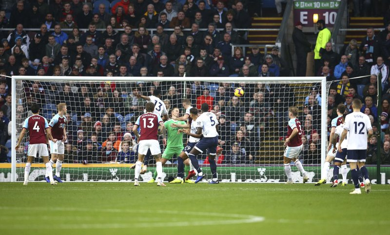 Everton's Yerry Mina scores his side's first goal of the game during the English Premier League soccer match between Burnley and Everton at Turf Moor, in Burnley, England, Wednesday, Dec. (Dave Thompson/ PA via AP)
