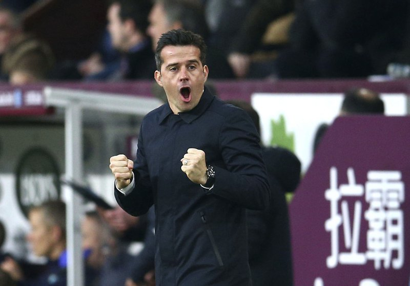 Everton manager Marco Silva celebrates Yerry Mina scoring his side's first goal of the game  during the English Premier League soccer match between Burnley and Everton at Turf Moor, in Burnley, England, Wednesday, Dec. (Dave Thompson/ PA via AP)