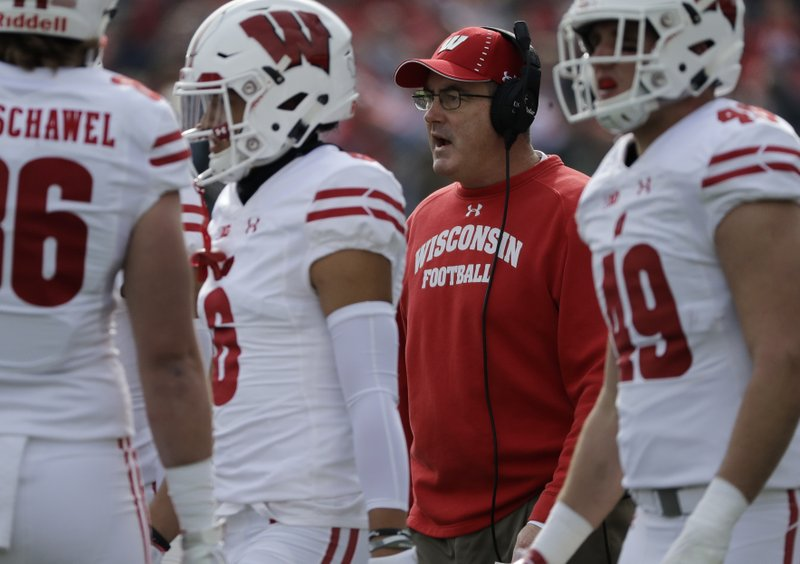 File-This Oct. 27, 2018, file photo shows Wisconsin head coach Paul Chryst talking to his team against Northwestern during the first half of an NCAA college football game in Evanston, Ill. (AP Photo/Nam Y. Huh, File)