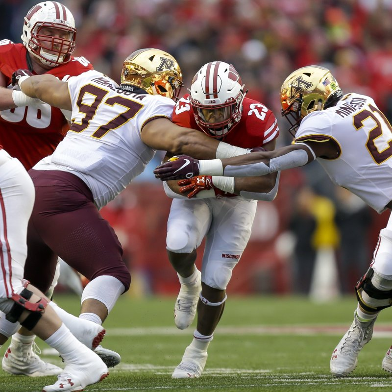 File-This Nov. 24, 2018, file photo shows Wisconsin running back Jonathan Taylor (23) running against Minnesota defensive lineman Royal Silver (97) and linebacker Kamal Martin (21) during the first half of an NCAA college football game in Madison, Wis. (165.8 yards per game) and had four 200-yard games.  (AP Photo/Andy Manis, File)