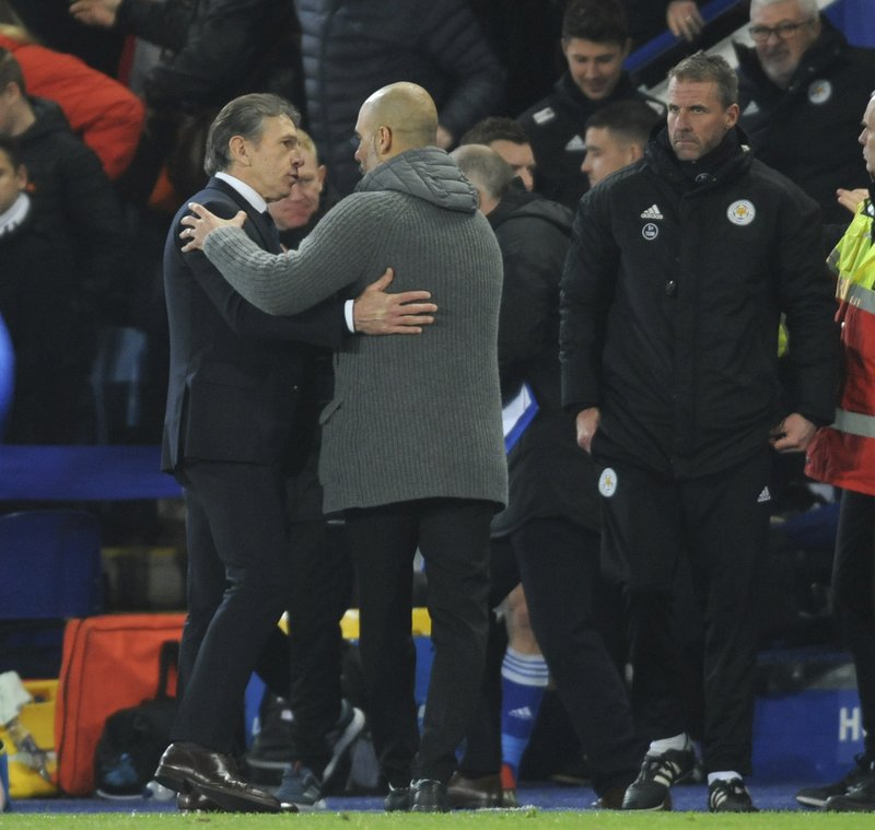 Leicester manager Claude Puel, left, and Manchester City manager Josep Guardiola shake hands after the English Premier League soccer match between Leicester City and Manchester City at the King Power Stadium in Leicester, England, Wednesday, Dec. (AP Photo/Rui Vieira)