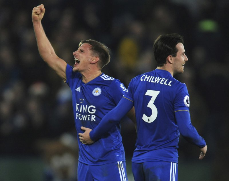 Leicester's Marc Albrighton, left, and Leicester's Ben Chilwell celebrate their victory during the English Premier League soccer match between Leicester City and Manchester City at the King Power Stadium in Leicester, England, Wednesday, Dec. (AP Photo/Rui Vieira)