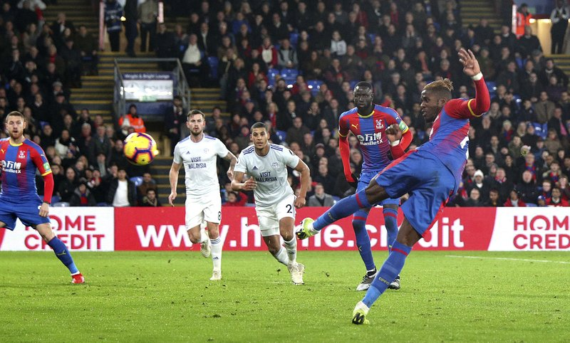 Crystal Palace's Wilfried Zaha attempts a shot on goal during the English Premier League soccer match between Crystal Palace and Cardiff City at Selhurst Park, in London, Wednesday Dec. (Yui Mok/PA via AP)