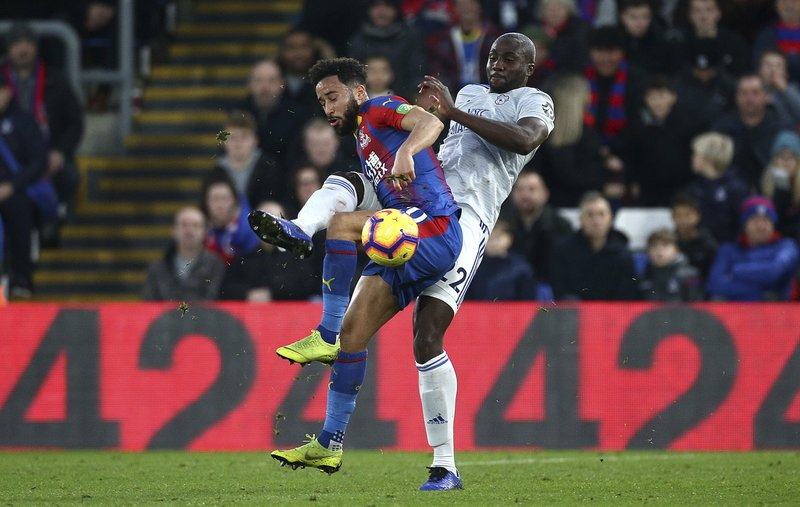 Crystal Palace's Andros Townsend, left and Cardiff City's Sol Bamba battle for the ball during the English Premier League soccer match between Crystal Palace and Cardiff City at Selhurst Park, in London, Wednesday Dec. (Yui Mok/PA via AP)