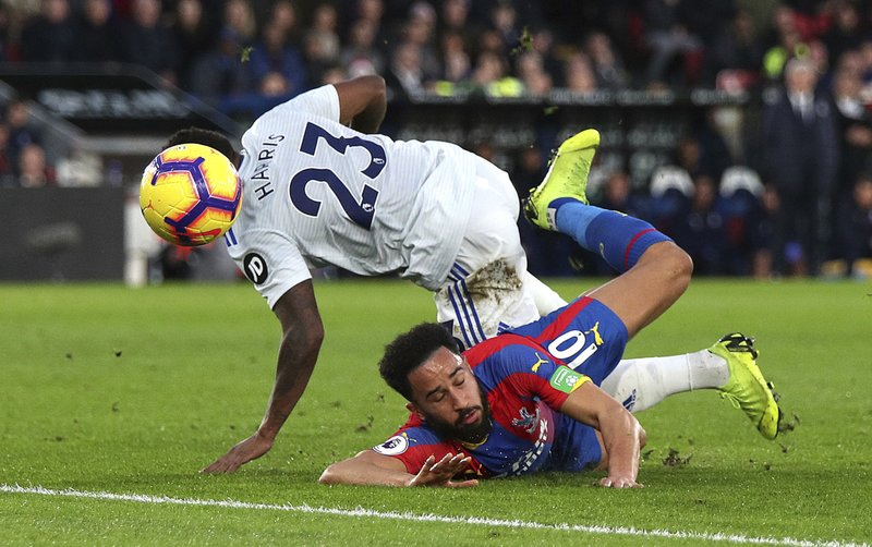 Cardiff City's Kadeem Harris, left and Crystal Palace's Andros Townsend battle for the ball, during the English Premier League soccer match between Crystal Palace and Cardiff City at Selhurst Park, in London, Wednesday Dec. (Yui Mok/PA via AP)