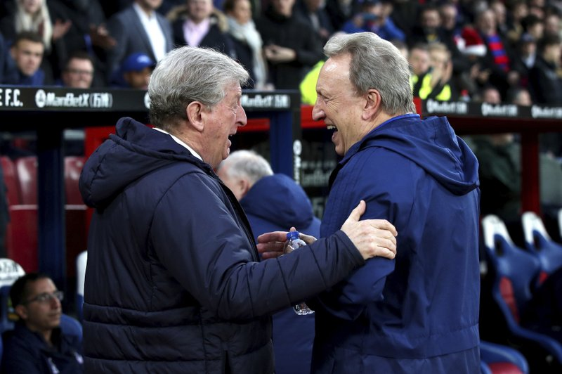 Crystal Palace manager Roy Hodgson, left and Cardiff City manager Neil Warnock react prior to the start of the English Premier League soccer match between Crystal Palace and Cardiff City at Selhurst Park, in London, Wednesday Dec. (Yui Mok/PA via AP)