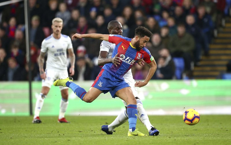 Crystal Palace's Andros Townsend, foreground, and Cardiff City's Sol Bamba battle for the ball, during the English Premier League soccer match between Crystal Palace and Cardiff City at Selhurst Park, in London, Wednesday Dec. (Yui Mok/PA via AP)