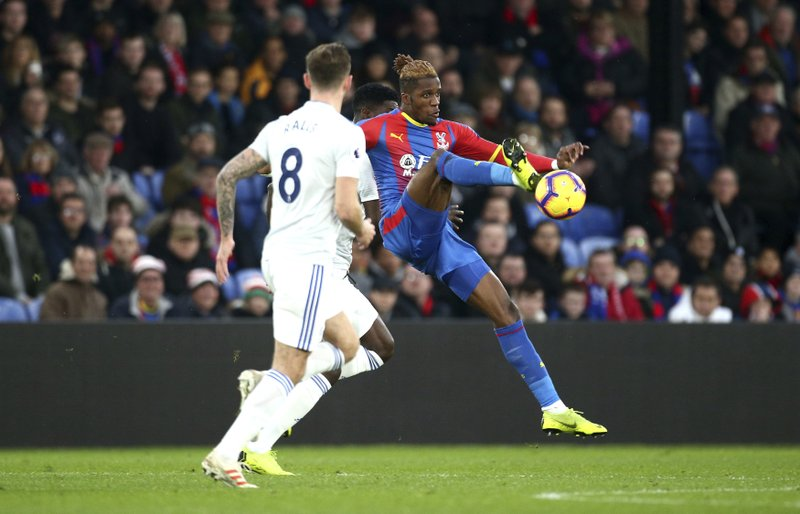 Crystal Palace's Wilfried Zaha controls the ball during the English Premier League soccer match between Crystal Palace and Cardiff City at Selhurst Park, in London, Wednesday Dec. (Yui Mok/PA via AP)