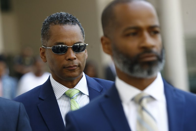 FILE - In this May 21, 2018, file photo, former Baltimore Police Commissioner Darryl De Sousa, left, departs a courthouse after making his initial court appearance on federal tax charges in Baltimore. (AP Photo/Patrick Semansky, File)