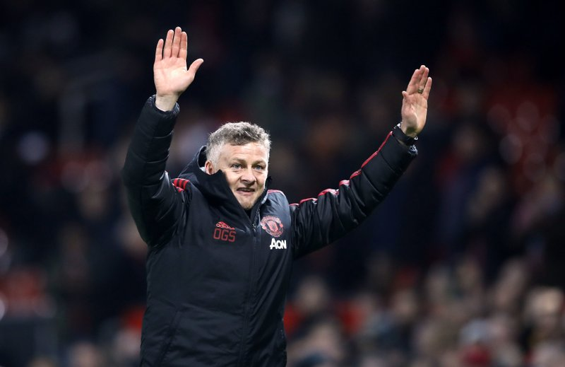 Manchester United interim manager Ole Gunnar Solskjaer celebrates defeating Huddersfield after the English Premier League soccer match  at Old Trafford, Manchester, England, Wednesday Dec. (Martin Rickett/PA via AP)