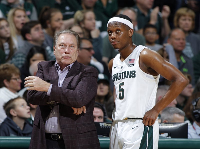 File-This Dec. 16, 2018, file photo shows Michigan State coach Tom Izzo, left, talking with Cassius Winston during the second half of an NCAA college basketball game against Green Bay,  in East Lansing, Mich. (AP Photo/Al Goldis, File)