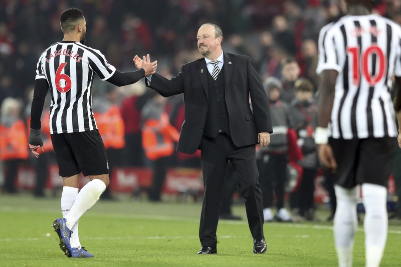 Newcastle coach Rafael Benitez, right, greets Newcastle's Mohamed Diame at the end of the English Premier League soccer match between Liverpool and Newcastle at Anfield Stadium, in Liverpool, England, Wednesday, Dec. (AP Photo/Jon Super)