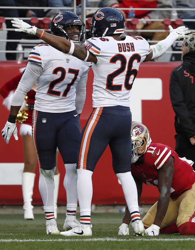 Chicago Bears defensive back Sherrick McManis (27) celebrates with defensive back Deon Bush (26) after a pass for San Francisco 49ers wide receiver Marquise Goodwin, bottom, fell incomplete during the second half of an NFL football game in Santa Clara, Calif. (AP Photo/Tony Avelar)
