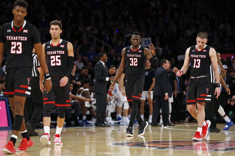 Texas Tech guard Jarrett Culver (23), guard Davide Moretti (25), center Norense Odiase (32) and guard Matt Mooney (13) walk to the bench during the first half against Duke in an NCAA college basketball game Thursday, Dec. (AP Photo/Adam Hunger)