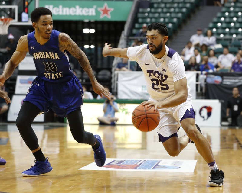 Indiana State guard Christian Williams (10) defends against TCU guard Alex Robinson (25) during the first half of an NCAA college basketball game at the Diamond Head Classic, Tuesday, Dec. (AP Photo/Marco Garcia)