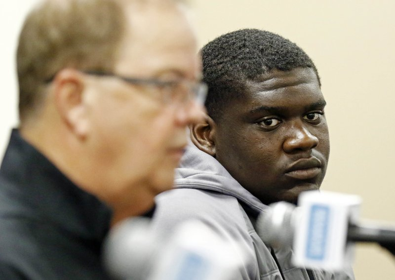 Duke's defensive tackle Derrick Tangelo, right, listens as football coach David Cutcliffe respond to reporters' questions during the 2018 Independence Bowl news conference in Shreveport, La. (Rogelio V. Solis/AP)