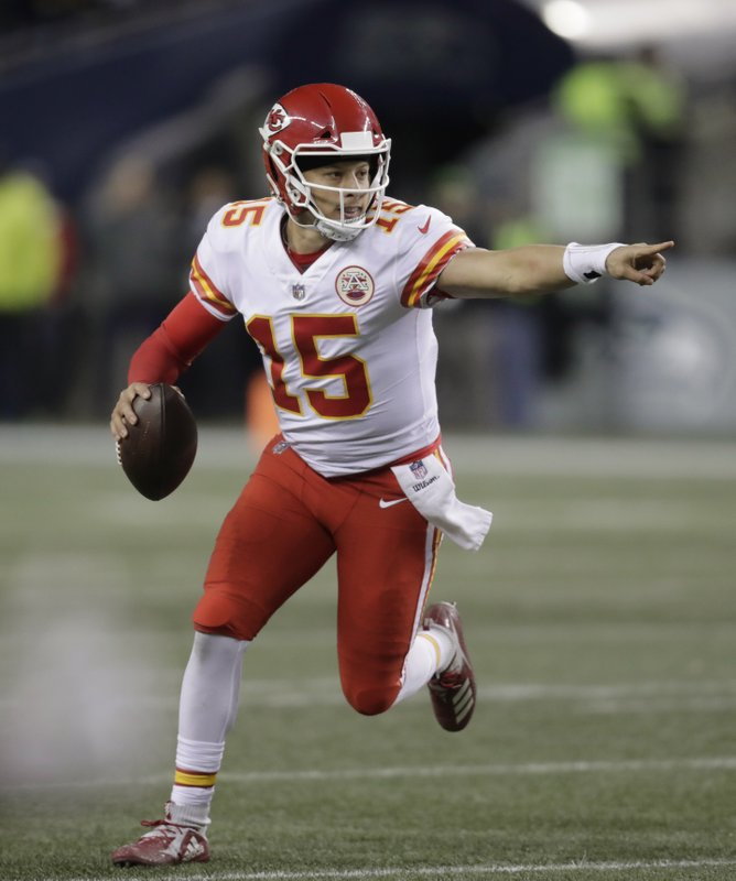 Kansas City Chiefs quarterback Patrick Mahomes scrambles with the ball during the second half of an NFL football game against the Seattle Seahawks, Sunday, Dec. (AP Photo/Stephen Brashear)