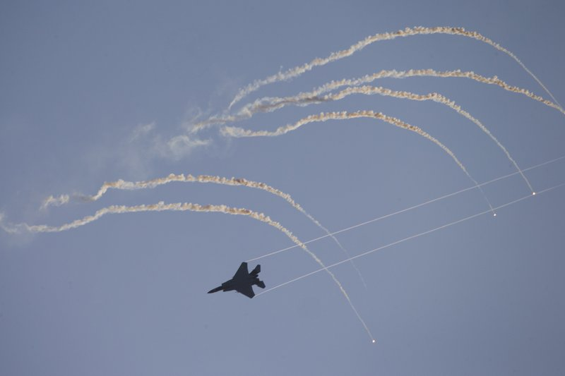 Israeli Air Force F-15 plane flies during a graduation ceremony for new pilots in Hatzerim air force base near the southern Israeli city of Beersheba, Israel, Wednesday, Dec. (AP Photo/Ariel Schalit)