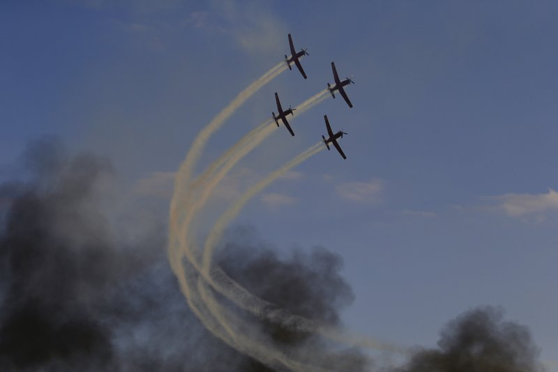 Israeli Air Force acrobatic team flies during a graduation ceremony for new pilots in Hatserim air force base near the southern Israeli city of Beersheba, Wednesday, Dec. (AP Photo/Ariel Schalit)
