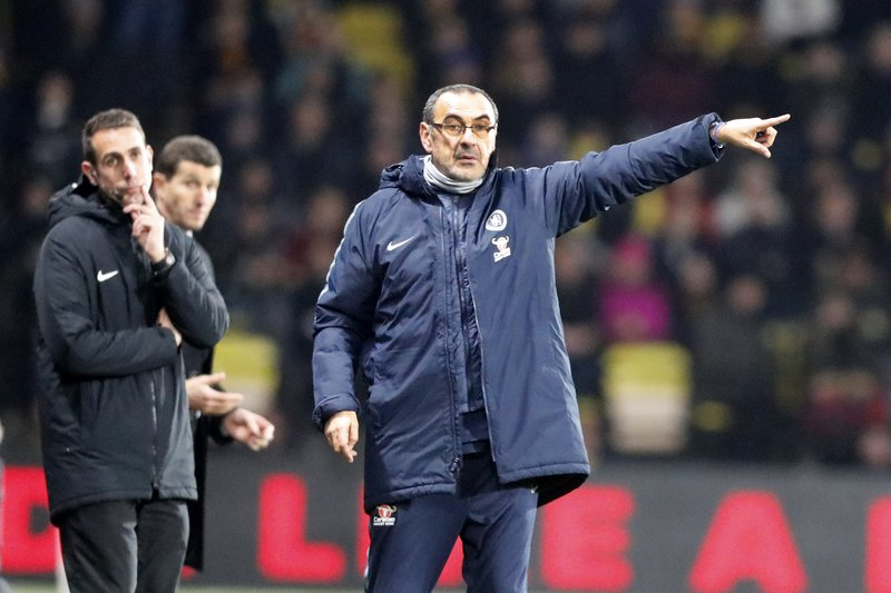 Chelsea's team manager Maurizio Sarri, center, gives instructions during the English Premier League soccer match between Watford and Chelsea at Vicarage Road stadium in Watford, England on Wednesday, Dec. (AP Photo/Frank Augstein)