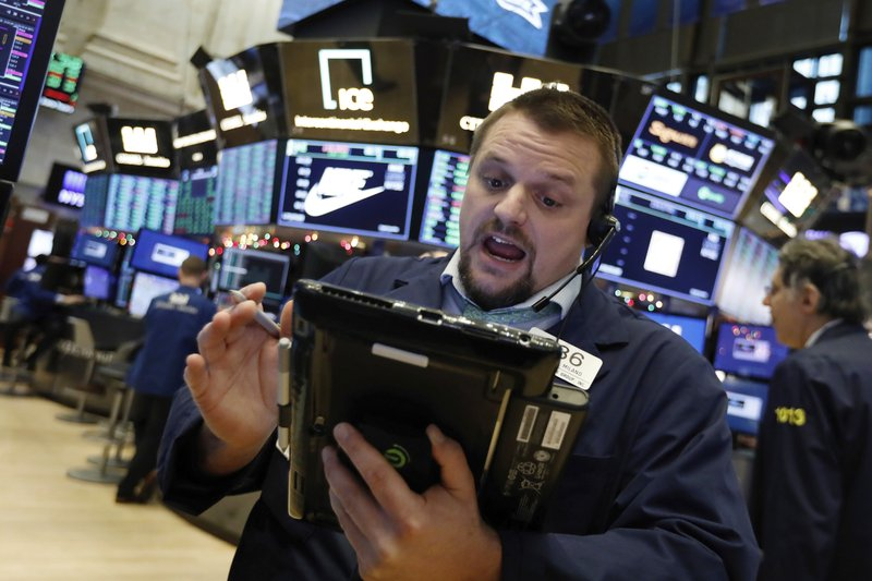 Trader Michael Milano works on the floor of the New York Stock Exchange, Wednesday, Dec. 26, 2018. Stocks are opening strongly higher on Wall Street Wednesday, with real estate, raw materials and energy stocks leading a broad rebound from Monday's steep losses. (AP Photo/Richard Drew)