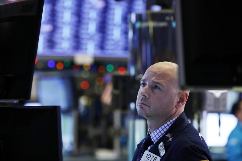 Specialist Mario Picone works on the floor of the New York Stock Exchange, Wednesday, Dec. 26, 2018. Stocks are opening higher on Wall Street Wednesday, with real estate, raw materials and energy stocks leading a broad rebound from Monday's steep losses. (AP Photo/Richard Drew)