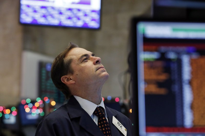 Trader Dudley Devine works on the floor of the New York Stock Exchange, Wednesday, Dec. 26, 2018. Stocks are opening strongly higher on Wall Street Wednesday, with real estate, raw materials and energy stocks leading a broad rebound from Monday's steep losses. (AP Photo/Richard Drew)