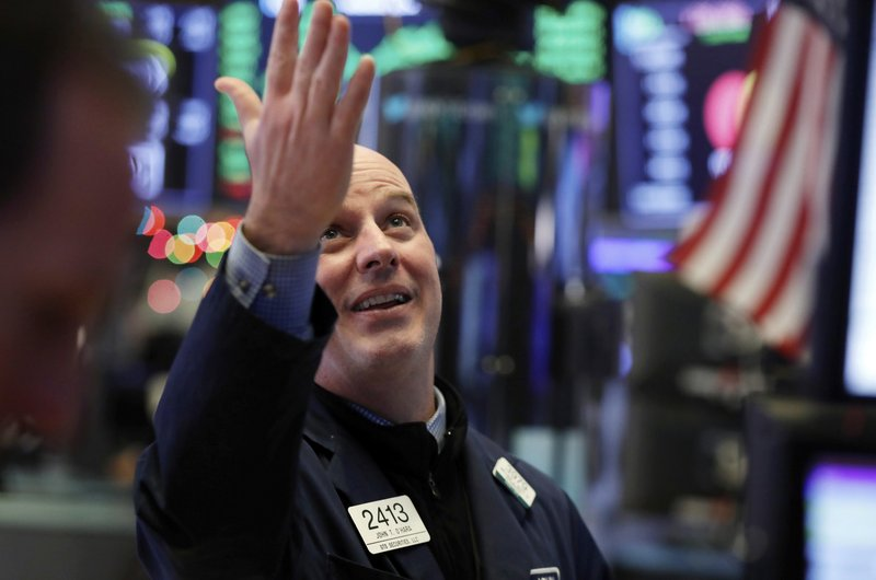 Specialist John O''Hara gestures as he looks at the Dow Jones industrial average before the closing bell on the floor of the New York Stock Exchange, Wednesday, Dec. (AP Photo/Richard Drew)