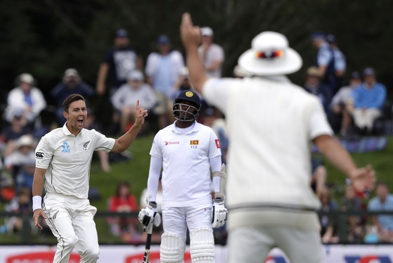 New Zealand's Trent Boult appeals successfully for the wicket of Sri Lanka's Lahiru Kumara during play on day two of the second cricket test between New Zealand and Sri Lanka at Hagley Oval in Christchurch, New Zealand, Thursday, Dec. (AP Photo/Mark Baker)