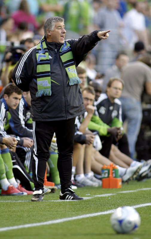 FILE - In this May 30, 2009, file photo, Seattle Sounders coach Sigi Schmid gestures from the sideline during the first half against the Columbus Crew in a MLS soccer match in Seattle. (AP Photo/Ted S. Warren, File)