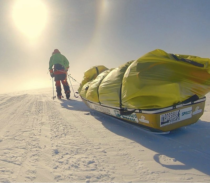 In this photo provided by Colin O'Brady, of Portland., Ore., he poses for a photo while traveling across Antarctica on Wednesday, Dec. (1,500-kilometer) journey across the continent in 54 days, lugging his supplies on a sled as he skied in bone-chilling temperatures. (Colin O'Brady via AP)