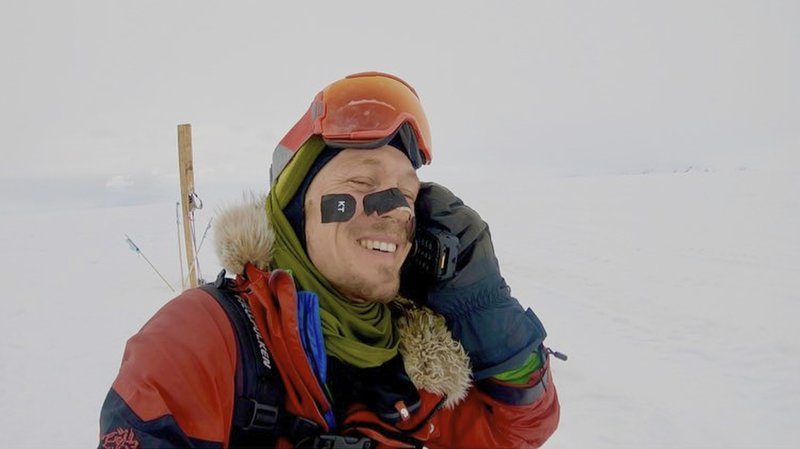 In this photo provided by Colin O'Brady, of Portland., Ore., he speaks on the phone in Antarctica on Wednesday, Dec. (1,500-kilometer) journey across the continent in 54 days, lugging his supplies on a sled as he skied in bone-chilling temperatures. (Colin O'Brady via AP)
