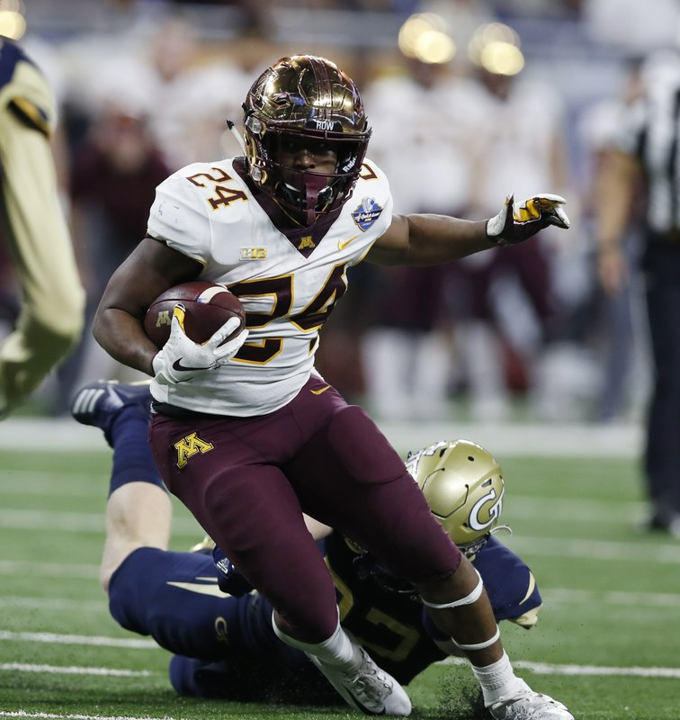 Minnesota running back Mohamed Ibrahim (24) carries during the first half of the Quick Lane Bowl NCAA college football game against Georgia Tech, Wednesday, Dec. (AP Photo/Carlos Osorio)