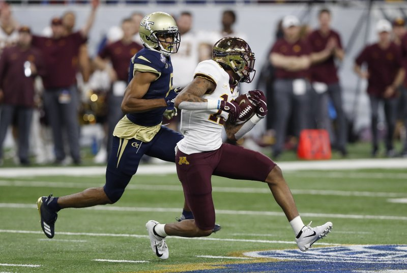 Minnesota wide receiver Rashod Bateman (13) is chased by Georgia Tech defensive back Lamont Simmons (6) during the first half of the Quick Lane Bowl NCAA college football game, Wednesday, Dec. (AP Photo/Carlos Osorio)