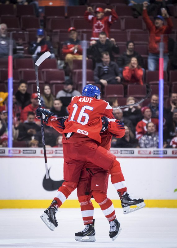 Czech Republic's Martin Kaut, front, and David Kvasnicka celebrate after Kvasnicka scored against Switzerland during overtim  in a world junior men's hockey championship game in Vancouver, British Columbia, Wednesday, Dec. (Darryl Dyck/The Canadian Press via AP)