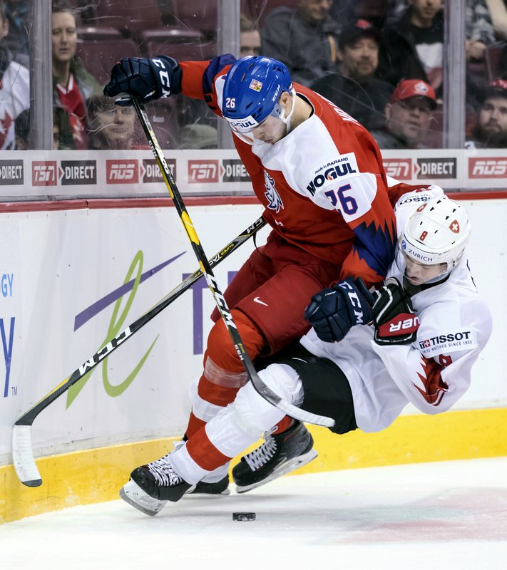 Czech Republic's Krystof Hrabik (26) and Switzerland's Janis Moser collide (8) during second period World Junior Hockey Championship action in Vancouver, British Columbia on Wednesday, Dec. (Darryl Dyck/The Canadian Press via AP)