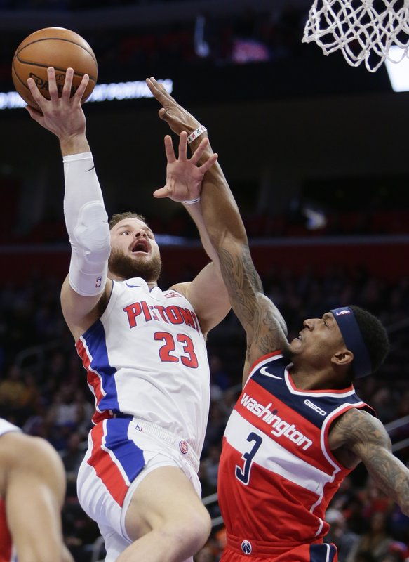 Detroit Pistons forward Blake Griffin (23) goes to the basket against Washington Wizards guard Bradley Beal (3) during the first half of an NBA basketball game Wednesday, Dec. (AP Photo/Duane Burleson)
