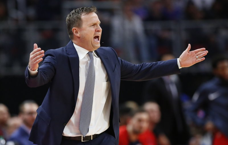 Washington Wizards head coach Scott Brooks yells out the officials during the first half of an NBA basketball game against the Detroit Pistons Wednesday, Dec. (AP Photo/Duane Burleson)