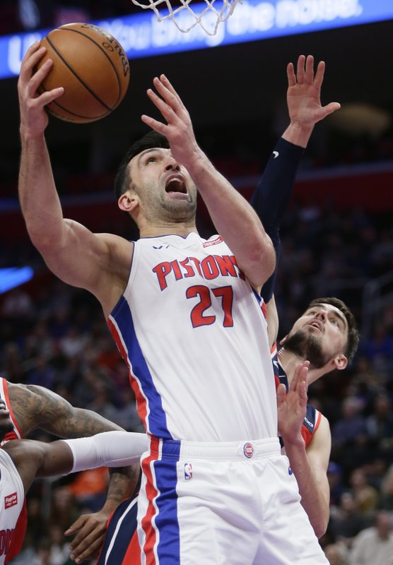 Detroit Pistons center Zaza Pachulia (27) is defended by Washington Wizards guard Ron Baker, right, while going to the basket during the first half of an NBA basketball game Wednesday, Dec. (AP Photo/Duane Burleson)