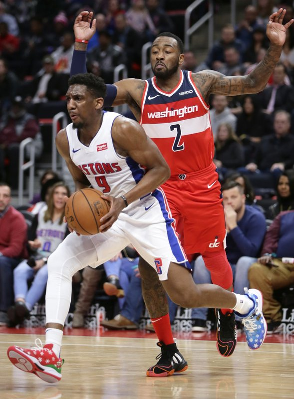 Detroit Pistons guard Langston Galloway (9) drives to the basket past Washington Wizards guard John Wall (2) during the first half of an NBA basketball game Wednesday, Dec. (AP Photo/Duane Burleson)