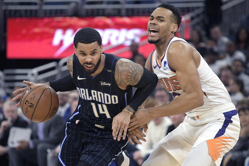 Orlando Magic guard D.J. Augustin (14) drives to the basket in front of Phoenix Suns guard Elie Okobo, right, during the first half of an NBA basketball game Wednesday, Dec. (AP Photo/Phelan M. Ebenhack)