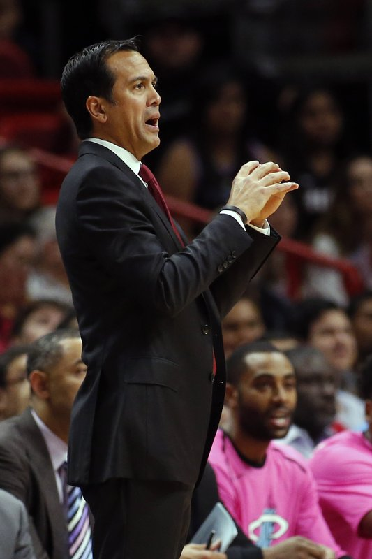 Miami Heat head Coach Erik Spoelstra directs the players during the first half of an NBA basketball game against the Toronto Raptors, Wednesday, Dec. (AP Photo/Joel Auerbach)