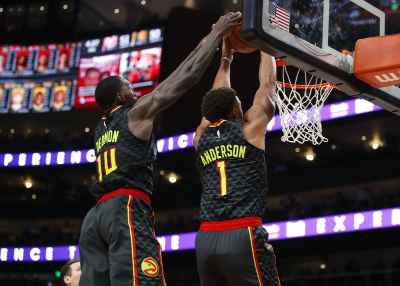 Atlanta Hawks guard Justin Anderson (1) and center Dewayne Dedmon (14) go up for the double jam in the first half of an NBA basketball game against the Indiana Pacers on Wednesday, Dec. (AP Photo/Todd Kirkland)
