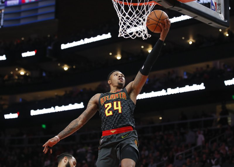 Atlanta Hawks guard Kent Bazemore (24) goes up for a layup in the first half of an NBA basketball game against the Indiana Pacers on Wednesday, Dec. (AP Photo/Todd Kirkland)