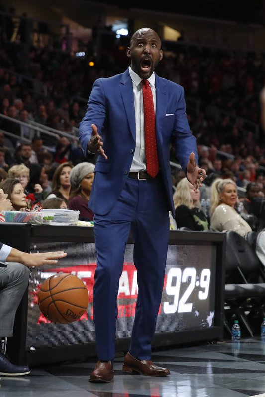 Atlanta Hawks head coach Lloyd Pierce reacts in the first half of an NBA basketball game against the Indiana Pacers on Wednesday, Dec. (AP Photo/Todd Kirkland)