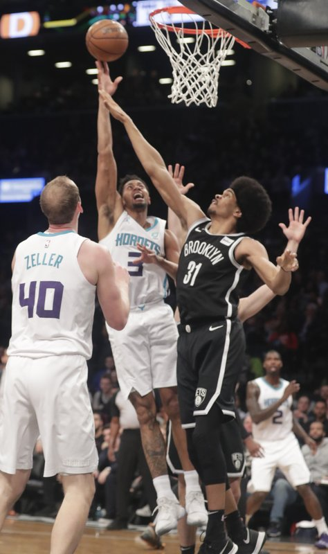 Charlotte Hornets' Jeremy Lamb (3) shoots over Brooklyn Nets' Jarrett Allen (31) during the first half of an NBA basketball game Wednesday, Dec. (AP Photo/Frank Franklin II)