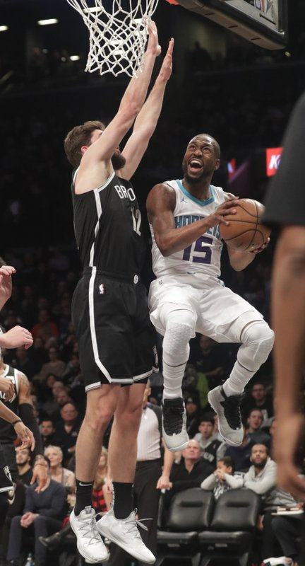 Charlotte Hornets' Kemba Walker, right, drives past Brooklyn Nets' Joe Harris during the first half of an NBA basketball game Wednesday, Dec. (AP Photo/Frank Franklin II)
