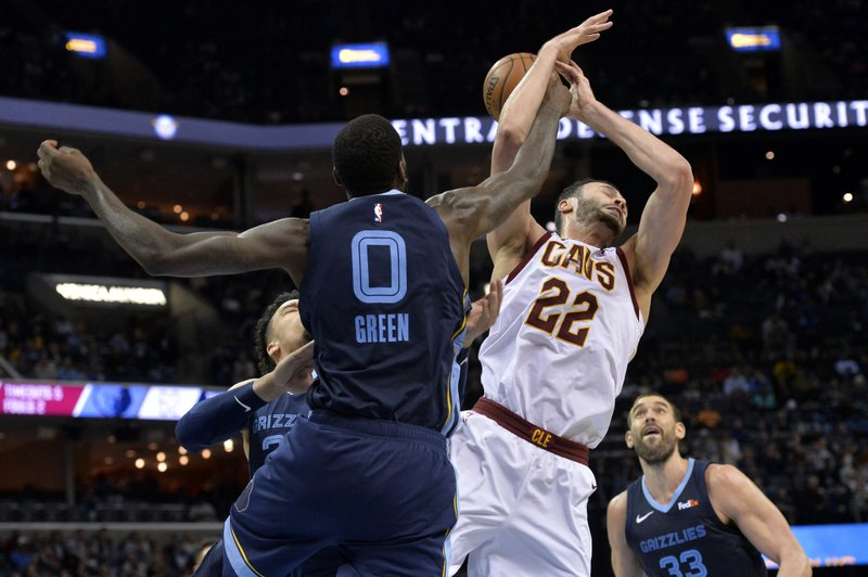 Cleveland Cavaliers forward Larry Nance Jr. (22) and Memphis Grizzlies forward JaMychal Green (0) struggle for control of the ball during the second half of an NBA basketball game Wednesday, Dec. (AP Photo/Brandon Dill)