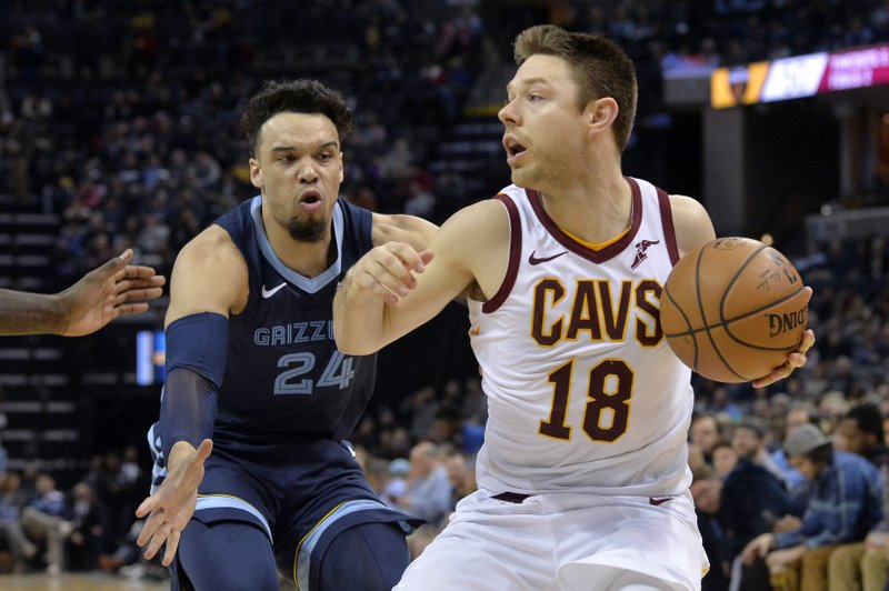 Cleveland Cavaliers guard Matthew Dellavedova (18) controls the ball as Memphis Grizzlies guard Dillon Brooks defends during the second half of an NBA basketball game Wednesday, Dec. (AP Photo/Brandon Dill)